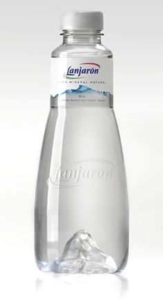Lanjaron Mineral Water - sleek, clear, grooveless shape of the bottle magnifies the mountain arising from its base