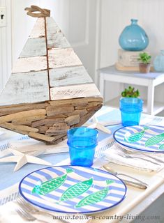 Cool blues and beach-themed dinnerware come together to create a coastal style table setting. See how easy it is to re-create this pretty tablescape.