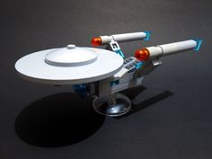 https://flic.kr/p/K6MuwF | USS Enterprise NCC-1701. mini size | This is my humble take on USS Enterprise NCC-1701, the central starship in The Star Trek universe. I built this also intended to be a tabletop mini display, to anticipate the latest Star Trek released in this month :) - Mini size. - Detailed bridge dome - Detailed cabin and engines - Photon torpedo launcher - Laser and phaser systems Humbly, here it is, USS Enterprise NCC-1701. mini size.
