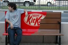 Street advertising by KitKat taking advantage of wide-format print's ability to customise benches