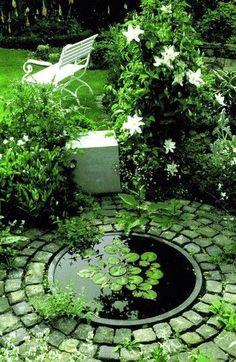 Circular sunken pond edged with granite setts. #Home Garden