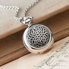 The Celtic knot dates to the 6th-century, when art from Ireland and the British Isles developed a style unique to the rest of Europe. Celtic Knot Pewter Pendant Watch | National Geographic Store