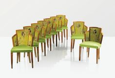 'MF 275', NINE SYCAMORE SIDE CHAIRS BY PIERRE CHAREAU, THE BACKS UPHOLSTERED AFTER A DESIGN BY JEAN LURÇAT, CIRCA 1924