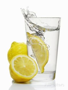 A Wedge of Lemon Falling into a Glass of Water Photographic Print by Kröger & Gross at AllPosters.com