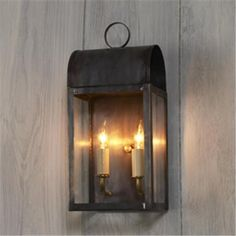 ooh this one is pretty.  arched outdoor light.  front door.