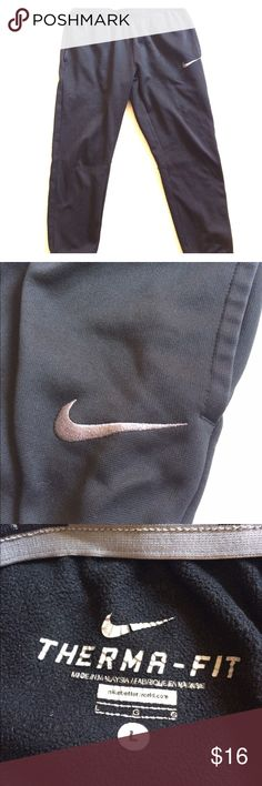 """Nike Therma-fit pants Used condition but excellent pants. As shown in last photo pants are missing the draw string. These pants have pockets on both sides. Should fall to the shin like a Capri Fleece inside.   Measured laying flat:  💜 15"""" waist 💜 10"""" rise  💜 27""""inseam   🌸🎀 I offer a bundle discount! Feel free to shop around my closet! Enjoy! 🎀🌸 Nike Pants Track Pants & Joggers"""