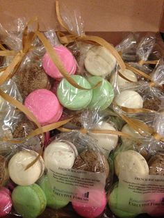 Custom corporate event giveaways - macaron flavors: dark chocolate, black raspberry white chocolate, pistachio, lychee-rose. Photo courtesy of Hilde Baumann Photography