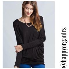 Comfortable Dolman Jersey Top The most comfortable top you will own. This is a Black dolman style jersey top with long sleeves. Perfect with jeans or leggings or even a pair of pj pants to snuggle up in.made of 95% rayon 5% spandex Made in the USA Love in Tops Tees - Long Sleeve
