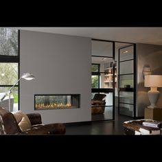 31 Stunning Modern Fireplace Design Ideas - There are many different ideas for creating modern fireplaces. In most instances, the fireplace is considered to be the focal point when it comes to i. Double Sided Gas Fireplace, Linear Fireplace, Freestanding Fireplace, Home Fireplace, Living Room With Fireplace, Fireplace Design, Fireplace Ideas, Corner Fireplaces, Double Sided Stove