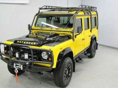 Land Rover Defender 110 Td4 Sw performed adventure in yellow