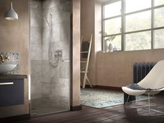 The Radiance Pivot for Recess is styled beautifully here, set in eastern inspired surroundings with riad style decorative splashback tiling and slate wall tiles off set with the roughness of worn plaster and warm wood flooring. #EclecticBathroom #WarmMetallic #WoodandMetal #RecessShowers