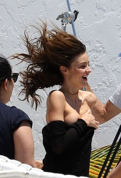 Miranda Kerr was participating in a Victoria's Secret photo shoot on Miami Beach wearing a black strapless top covering her boobs when suddenly the top fell down revealing her gorgeous little boobs. Click through for all of the pictures.