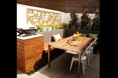 Dan and Dani's Challenge House Courtyard. Love the space saving bench seat and using it as part of the table seating #theblock2012