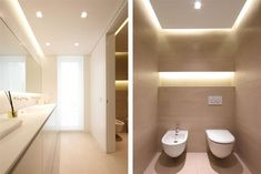 Compact, modern bathroom with drop-ceiling concealing lighting and floor to ceiling window.