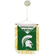 """Michigan State Spartans 3.5"""" x 4.5"""" Team Mini Banner Flag. Display your Spartans pride anywhere with this novel team mini banner! It's ideal for windows, rear view mirrors or any space that needs some team spirit.Team logo and colorsFringed edgesSuction cup and string includedApproximately 3.5"""" x 4.5""""ImportedOfficially licensed NCAA product"""