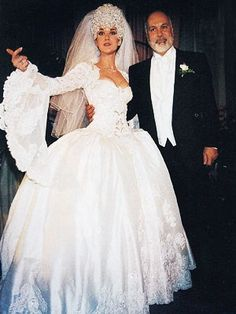 On December 17, 1994, 26-year-old Celine Dion wed her longtime manager, Rene Angelil, 51, at the Notre Dame Basilica in Montreal, Quebec. The bride wore a French marquise gown designed by Elwyn Brooks White that reportedly took 1,000 hours to complete, and featured a 20-foot train. Some say the real star of the wedding was the seven-pound headpiece with a cathedral length veil containing 2,000 Austrian crystals.
