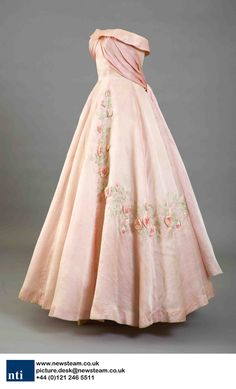 A debutantes dress from the 1958 Season created by couture designer Worth. The dress is displayed at Kensington Palace, London