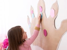 """Princess Party Games and activities - """"""""Pin the Gem on the Crown,"""" a riff on """"Pin the Tail on the Donkey"""" is a lively activity that requires very few materials. Just trace the crown shape onto brown craft paper, cut it out and tape at the eye-level of your guests. Cut random gem shapes out of metallic or glittery paper, and allow the princesses to take turns """"pinning."""" '"""