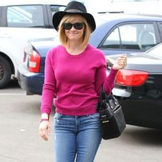 Reese Witherspoon's Pink Sweater and Black Hat Outfit