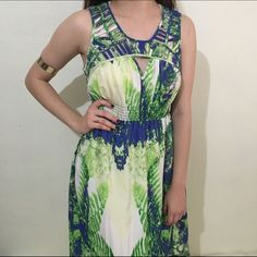 PRINTED HIGH LOW DRESS High low dress with cutout strips along the bust infront and back. Make an offer! Dresses High Low