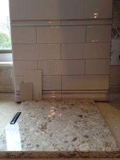 Cambria Windermere quartz countertops, subway tile backsplash, BM Revere Pewter or Pashmina on walls.