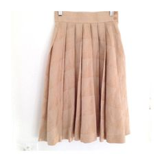 Pleated linen skirt by Japanese vintage brand Alpha Cubic. High waisted tan pleated skirt with subtle woven abstract pattern. Side zip closure with two buttons. Waist: 24. Length: 26 9 oz.