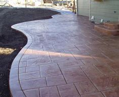 stamped concrete under deck patio | For all your Concrete Projects give The Concrete Cowboys a call