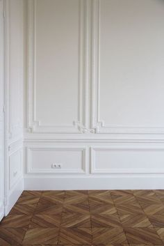 white walls and wooden floors