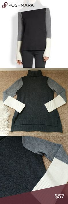 "Vince Wool/Cashmere Blend Color Block Sweater Great condition, no pills/pulls/etc., fabric/care tag removed but it's a wool/cashmere blend (soft, not itchy), dark gray (almost black) main body with light gray/beige color blocking on arms, split hem with slight hi/lo drape, 23.5"" L in front, 25.5"" L in back, 19"" across bust, recommend handwash and drying flat, or dry clean Vince Sweaters Cowl & Turtlenecks"