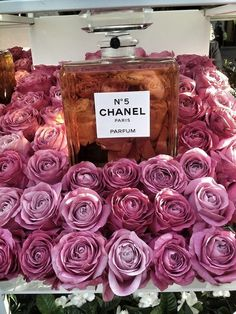 The iconic Chanel No. 5 perfume and roses for the lady