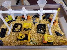Corn Construction Bin - PVC pipes and funnels allow the kids to load up their trucks and dump them elsewhere! Farm Sensory Bin, Toddler Sensory Bins, Sensory Tubs, Sensory Rooms, Toddler Learning Activities, Fun Activities For Kids, Infant Activities, Preschool Activities, Motor Activities