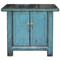 The overhanging top of this two door blue lacquered chest makes this piece unique and interesting.