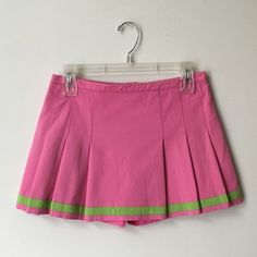 Lilly Pulitzer Tennis Skirt Palm Beach Collection Lilly Pulitzer Maureen tennis skort, part of the Palm Beach Collection in hibiscus pink. Hidden back zipper with hook and eye closure. 94% Cotton 6% Spandex. Gently worn but in good condition!! Offers welcome! Lilly Pulitzer Skirts