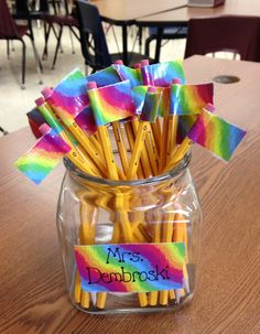 Inexpensive, colorful duct tape to flag  pencils /pens and help prevent them from disappearing!