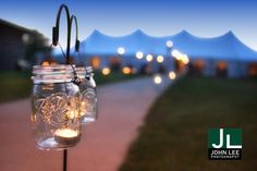 Mason jars with tea lights on shepherds hooks would be very pretty leading down the ceremony stairs. Very romantic and inexpensive addition