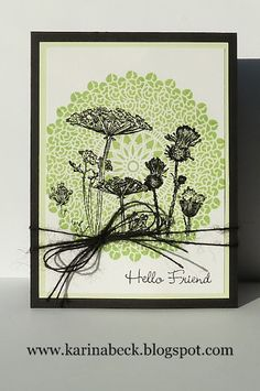 interesting combination of background, floral stamps, and embellishments...
