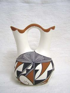 a weekend in the desert made me fall in love with native american style pottery, namely hand-painted wedding vases like this one.