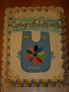 Girl Scout Cake For The Daisy Troop Buttercream with fondant apron and fondant daisies. Investiture Ceremony, Daisy Girl Scouts, Food Items, Daisies, Troops, Cake Ideas, Brownies, Cake Decorating, Awards