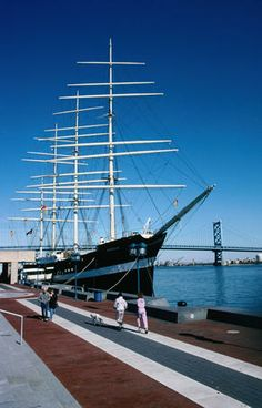 Walking past the large sailing ship docked at the wharf on the Savannah River