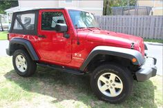 Car brand auctioned:Jeep Wrangler X Sport Utility 2-Door Jeep Wrangler 2009 Red