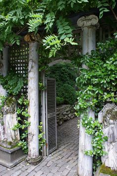 Old Salvaged Garden Getaway...graceful worn white columns.