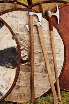 weapons and shields  Viking shields and axes. The Vikings used the long ax like no other warriors did. Very interesting choices. Effective though.
