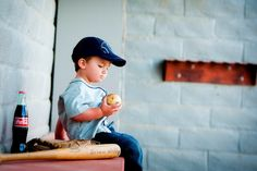 Vintage baseball shoot-can see my princess sipping from a coke bottle with her big brothers bat & glove as props :)