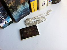 Hey, I found this really awesome Etsy listing at https://www.etsy.com/listing/195539012/once-upon-a-time-book-necklace