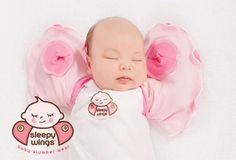 Sleepy Wings Swaddling Jacket ~ Sleepy Wings is a unique infant slumber wear jacket, designed to mimic the swaddling method of wrapping, however, without the excess layers making Sleepy Wings ideal for all seasons... comes in pink, blue and white