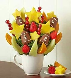 chocolate strawberry footballs in fruit arrangement