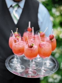 Summer Strawberry Sangria 1 Bottle Moscato or Sparking White Wine 3/4 cup Strawberry Schnapps 2 Tablespoons Sugar 1 bag frozen Strawberries, sliced or whole Mix all ingredients, let sit for about 15 minutes. Serve over ice. Yum!