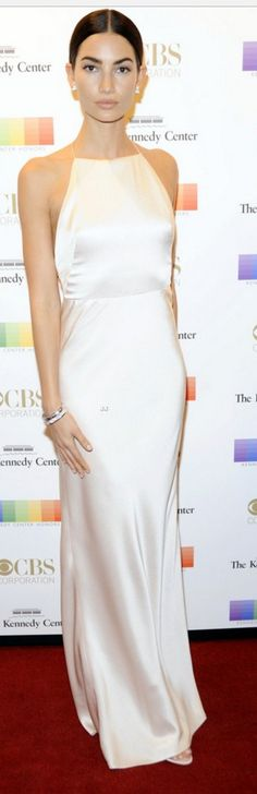 Who made Lily Aldridge's white satin gown, jewelry, and crystal sandals?