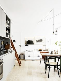 Inside a Monochrome Apartment With Warm Wood Accents via @MyDomaine