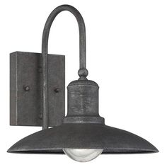 Cast a warm glow in your office or entryway with this stylish wall sconce, a handsome addition to your well-decorated home.  Product...